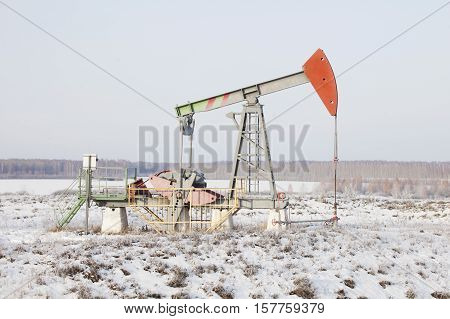 Oil derrick (pump jack). Bashkortostan Russia. Petroleum-producing
