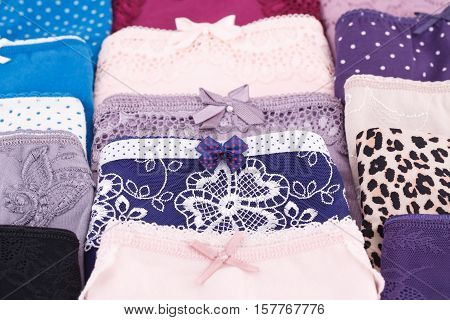 Many colorful panties close up horizontal picture.