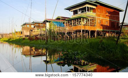 Traditional houses on stilts in Inle lake Myanmar