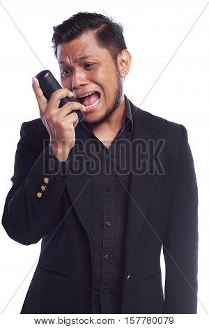 Men Showing His Expression Shouting While He Pointing His Talking On The Phone