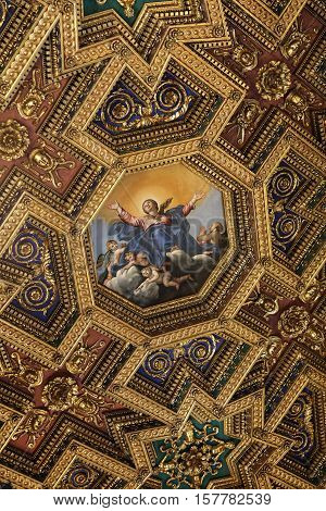 ROME, ITALY - JUNE 13, 2015: interiors and architectural details of basilica di Santa Maria in Trastevere in Rome Italy. Octagonal ceiling painting Assumption of the Mary by Domenichino