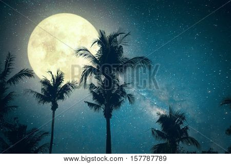 Beautiful fantasy palm tree tropical beach with Milky Way star in night skies wonderful full moon - Retro style artwork with vintage color tone (Elements of this moon image furnished by NASA)