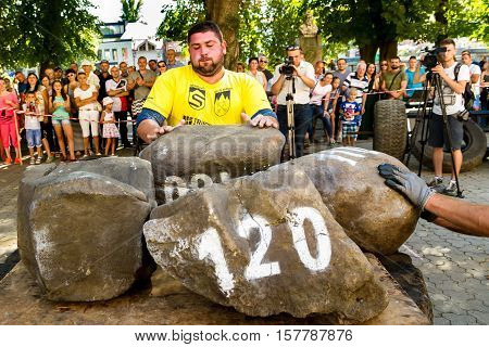 Uzhgorod Ukraine - August 28 2016: Strongmen perform exercise during the 13th power tournament