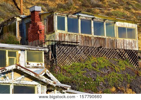Dilapidated homes on a cliff which is in need of remodeling