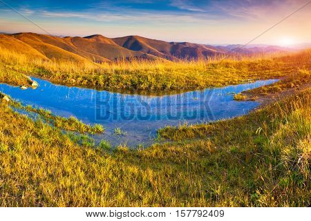 Colorful Autumn Morning In The Carpathian Mountains With Big Puddle