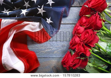 Roses and USA flag on wooden background. Symbol of America