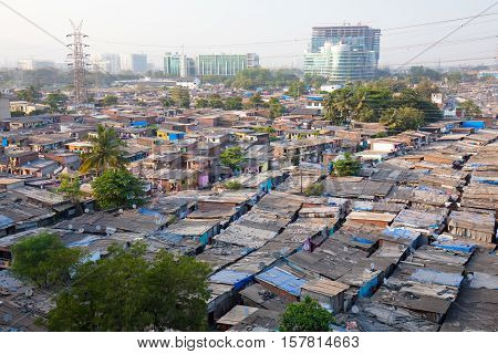 Rooftops at sunset of a slum in the district of Airoli in Mumbai, India