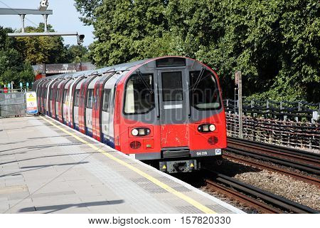 London, UK, August 19 2012: Underground tube train entering Kilburn Station on its route along the Jubilee Line