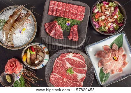 Full table of food for Chinese hot pot, beef, shrimp, pork and vegetable