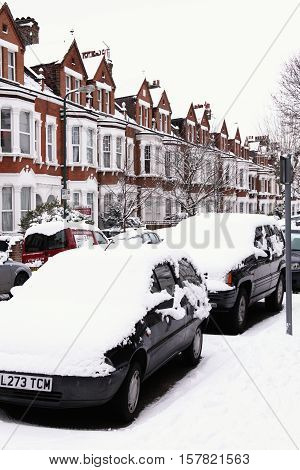 London, UK, December, 19 2010: A heavy snow fall covering cars in a Kilburn street bringing transport to a standstill