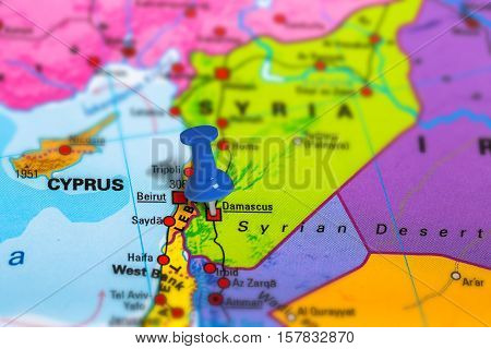 Damascus in Syria pinned on colorful political map of Asia. Geopolitical school atlas. Tilt shift effect.