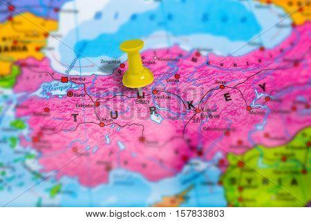 Ankara capital city in Turkey pinned on colorful political map of europe. Geopolitical school atlas. Tilt shift effect.