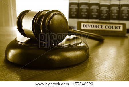 Legal gavel with Divorce Court placard and law books
