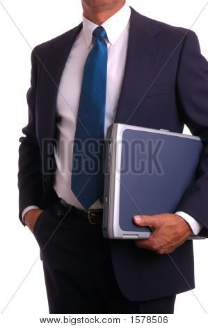 Businessman Holding Laptop Hand In Pocket