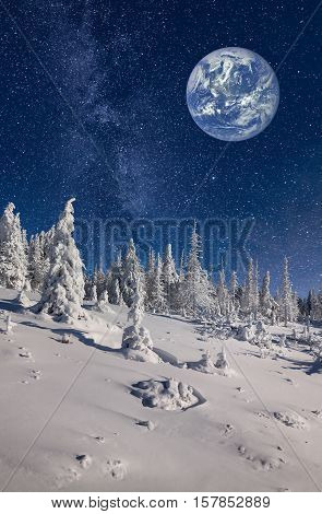 Imaginary view of big blue planet in the sky on winter backgroud. Elements of this image furnished by NASA.