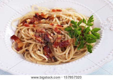 Italian pasta carbonara, spaghetti with pancetta bacon, egg and cheese sauce