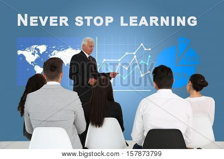 Business trainer at conference. Business coaching and development concept. Text NEVER STOP LEARNING on background.