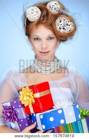 Redheaded girl with new-year decorations in a hair-do. Beautiful New Year and Christmas Tree Holiday Hairstyle and Make up.