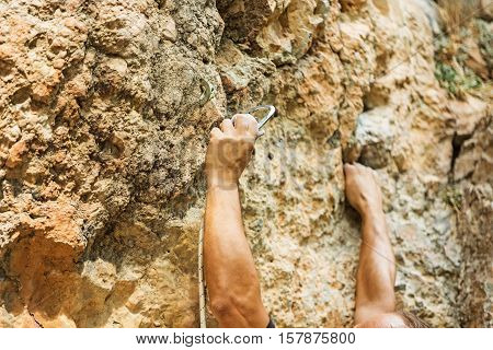 male left hand with chalk powder in cliff climbing sport, Ao Nang, Krabi, Thailand