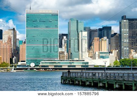 View of the midtown Manhattan skyline across the river from Queens including the United Nations building
