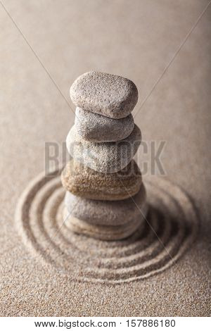 Zen Garden with Raked Sand and Balancing Pebbles