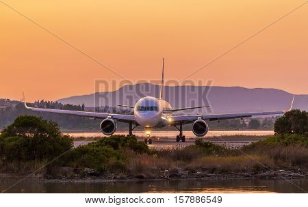 Airplane on runway before take off in airport of Corfu