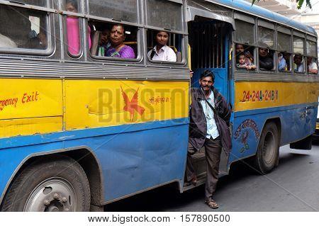 KOLKATA, INDIA - FEBRUARY 11: People on the move come in the colorful bus in Kolkata, India on February 11, 2016.