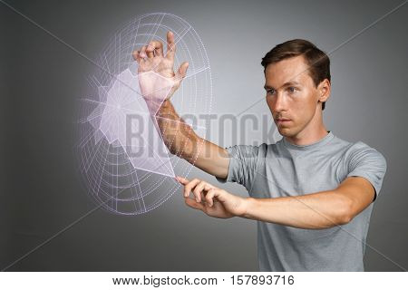 Man working with interactive Sci-Fi HUD interface.