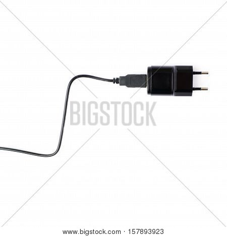 Fragment of the black usb adapter charger isolated over the white background