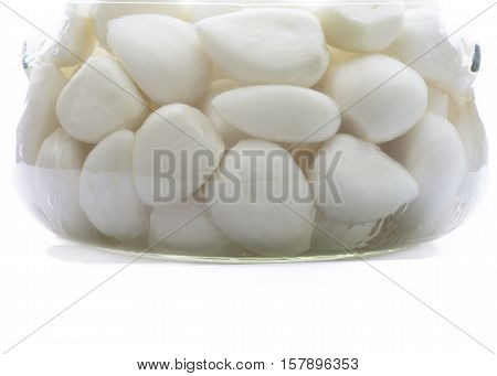 close up shot of organic garlic in a glass storage jar