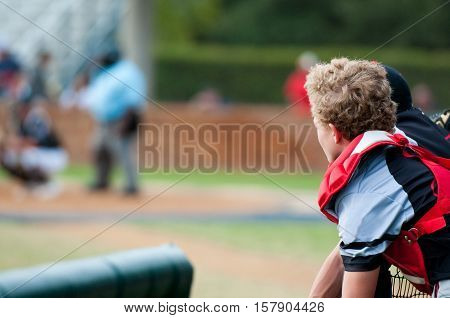 Baseball boy looking at camera during the game with copy space.