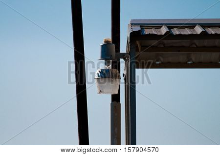 The lamp on the edge of a boat dock at a lake.