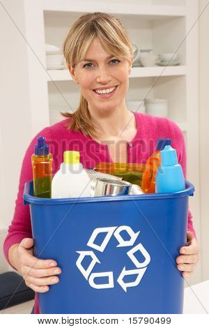 Woman Holding Recyling Waste Bin At Home