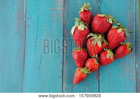 Group Of Fresh Red Strawberries In A Shape Of One Big Red Strawberry