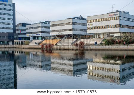 NORRKOPING, SWEDEN - NOVEMBER 20, 2016: Motala river flowing through the city center in Norrkoping.  Norrkoping is a historic industrial town in Sweden