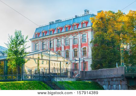 Building of the Higher School of Folk Arts at Griboyedov Canal embankment in St Petersburg Russia - closeup facade view. Architecture landmark of St Petersburg Russia in sunny autumn day