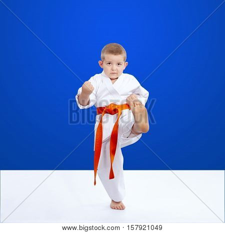 Blow leg is training athlete on a blue background