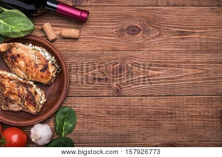 Spinach and feta stuffed chicken breast  on the wooden background .