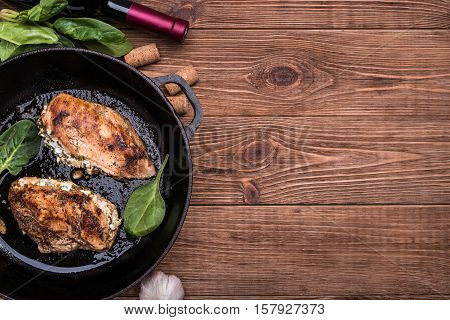 Spinach and feta stuffed chicken breast in a frying pan.