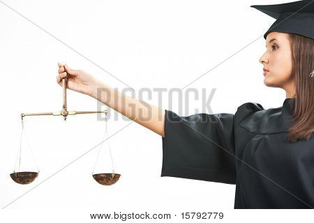 Young judge holding scales in isolation