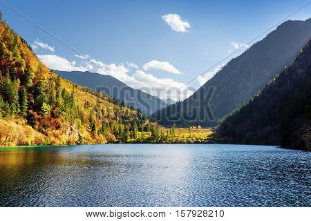 Scenic View Of The Panda Lake Among Colorful Fall Forest