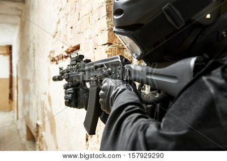 Special forces armed with machine gun ready to attack
