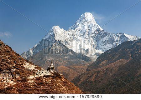 Mount Ama Dablam with stupa near Pangboche village - way to mount Everest base camp - Khumbu valley - Nepal