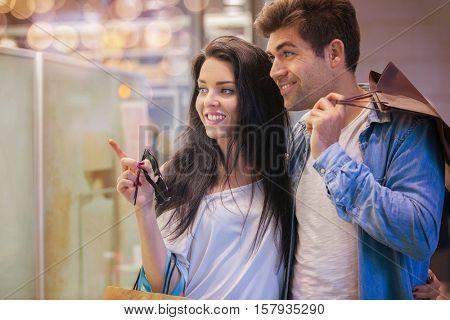 couple od people window shopping