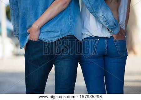 couple in jeans walking