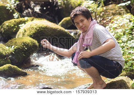 Portrait rimlight asia man at cataract river