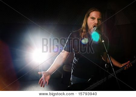 Heavy metal guitarist singing in studio