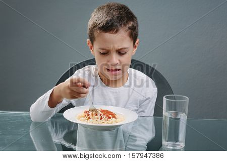 Portrait Of Child With No Appetite In Front Of The Meal. Concept Of Loss Of Appetite
