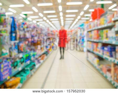 Blurred of kids toy department of store with unrecognizable customer as background