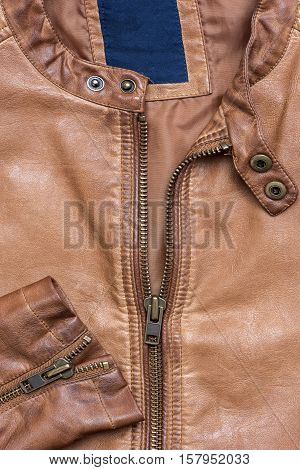 Brown leather jacket with zipper in close up view